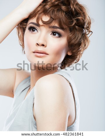 Close up face of beautiful model with short hair.