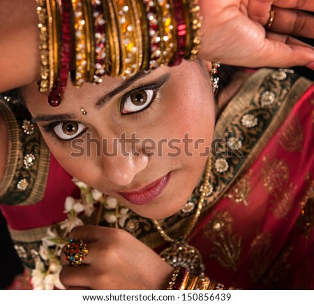 Close up face of beautiful young Indian woman in traditional sari dress