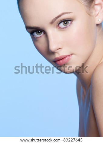 Close-up face of beautiful young woman with fresh skin - stock photo