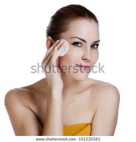 Close-up face of beauty young woman applying face foundation - stock photo
