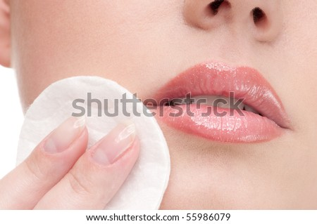 Close-up face of beauty young woman applying face foundation by sponge - stock photo
