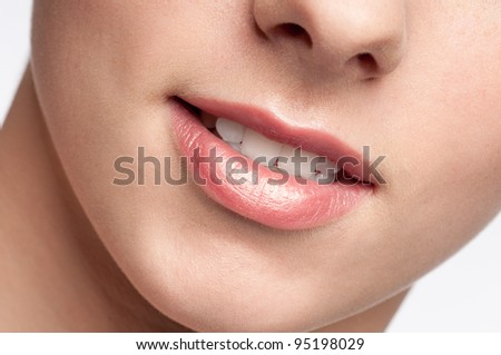 Close-up face of beauty young woman - lips make-up zone - stock photo