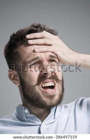 Close up face of desperate man  - stock photo