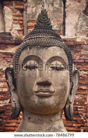 Close-up Face of Old Buddha in Wat Phra Si Rattana Mahathat Temple Ayutthaya , Thailand. - stock photo