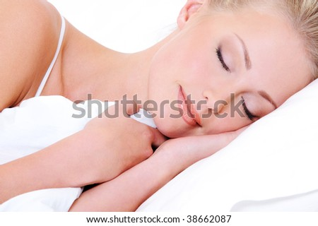 Close-up face of pretty beautiful woman sleeping in the white  pillow
