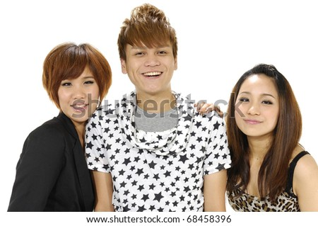 Close-up face of three funny friend laughing and having fun - stock photo