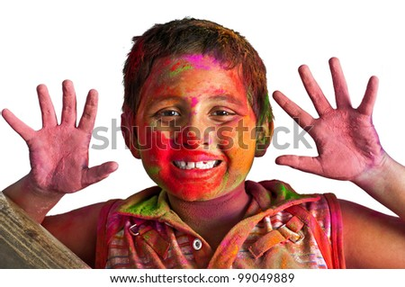 Close up face of young boy playing Holi, smiling with colors on face and hands, White Background, Happy Child - stock photo
