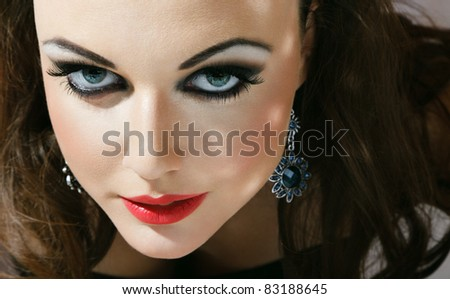 Close-up face of young woman with fashionable make-up - stock photo