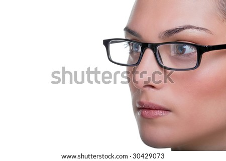 Close up face portrait of a woman wearing glasses - stock photo