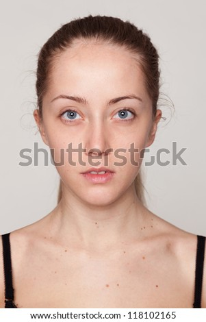 Close-up face portrait of young woman  without make-up. Natural image without retouching . Shallow depth of field. - stock photo