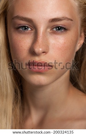 Close-up face portrait of young woman without make-up. Natural image without retouching w/shallow  - stock photo