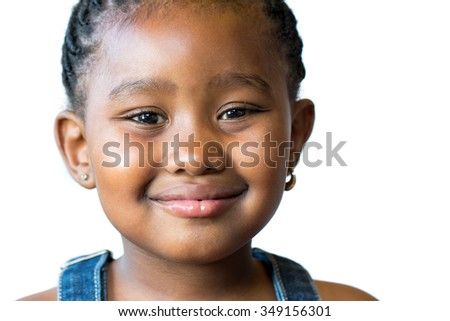 Close up face shot of cute little african kid isolated on white background.