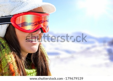 Close up face shot of female skier with goggles and reflection. - stock photo