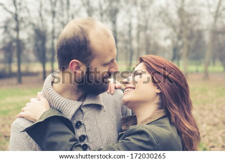 close up faces of couple in love at the park winter
