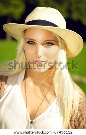 Close up facial shot of beautiful sensual blonde woman with sparkling eyes looking directly at camera. - stock photo