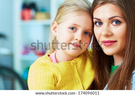Close up Family portrait. Mother, daughter. Happy girl. Home background.