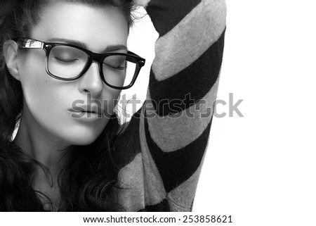 Close up fashion model girl with casual style wearing trendy glasses, Holding her hair with closed eyes. Cool trendy eyewear portrait in black and white. isolated on white background with copy space