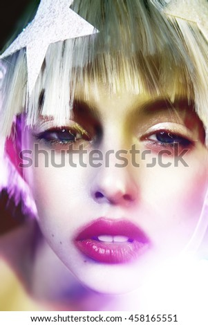 close up fashion portrait of a stunning blonde beauty model blur fusion light style