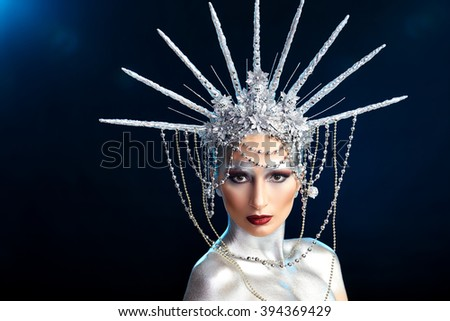 close up fashion portrait of a woman with body paint looking like a Statue of Liberty  - stock photo