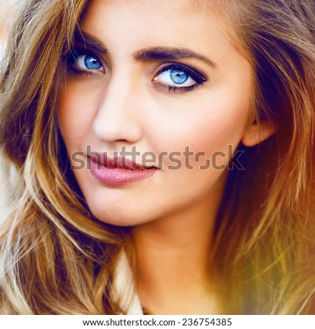 Close up fashion portrait of blonde sexy girl with magnetic blue eyes, stylish hairstyle and bright makeup. - stock photo