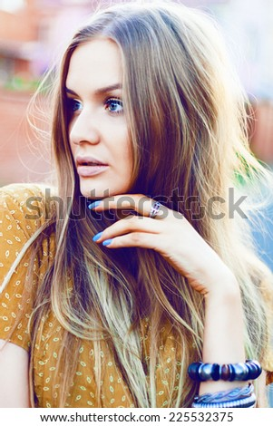 Close up fashion portrait of pretty sensual girl with natural make up and long straight blonde hairs. Soft pastel vintage colors. - stock photo