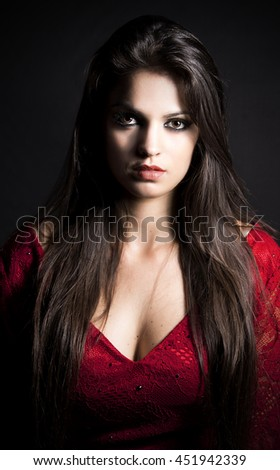 close-up fashion portrait of young beautiful sexy woman.Beauty brunette girl with make-up.elegant lady in red dress - stock photo