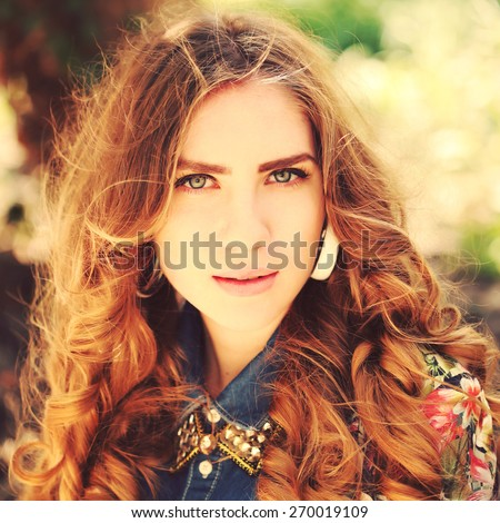 Close up fashion portrait of young sexy sensual seductive woman with perfect fluffy curled blonde hairs and clear skin with a retro vintage instagram filter - stock photo
