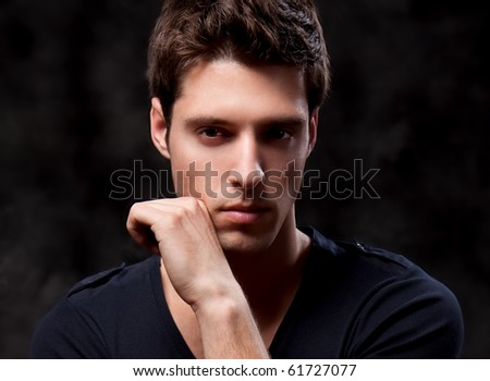 Close up Fashion Shot of a Young Man A trendy European man dressed in contemporary cloth. He is now a professional model. - stock photo