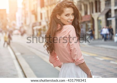 Close-up Fashion woman portrait of young pretty trendy girl posing at the city in Europe,summer street fashion, smiling portrait. - stock photo