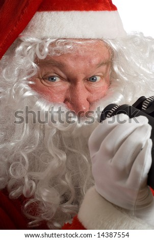 Close up Father Christmas with a jolly look in his eye and binoculars - stock photo