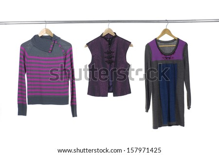 Close up female three clothes hanger on hangers - stock photo