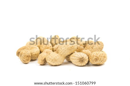 Close-up few peanuts isolated on a white background. - stock photo