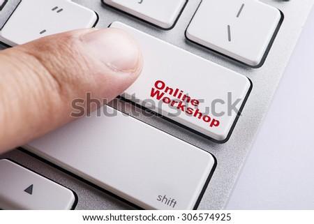 Close up Finger on keyboard-Online Conceptual Digital Workshop - stock photo
