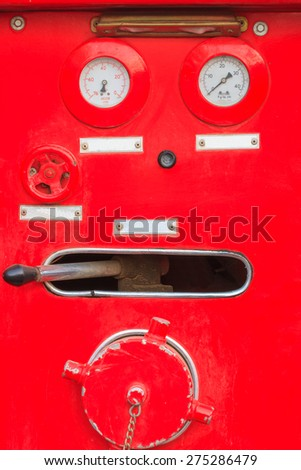 Close up fire engine  truck are operating - stock photo