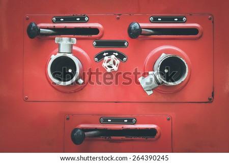 Close up Fire truck hose connectors, retro filter effect  - stock photo
