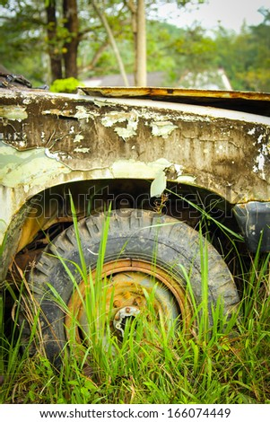 Close up Flat tire on the road waiting for repair - stock photo