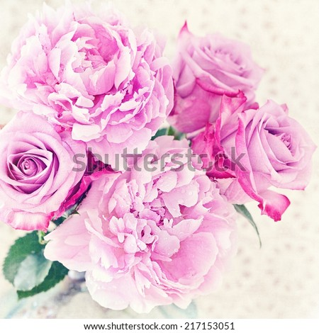 Close-up floral composition with a pink peony and roses . - stock photo