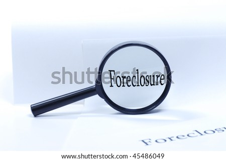 close up foreclosure by magnifying glass