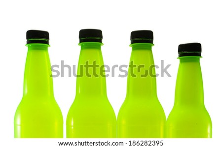 close up four green color plastic bottle empty isolate on white background