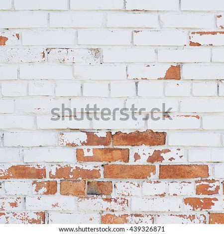Close-up fragment of an old brick wall as a background texture composition - stock photo