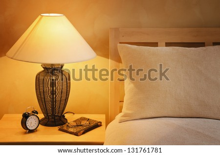 Close Up Fragment Of The  Bedroom With Reading Lamp And Alarm Clock - stock photo