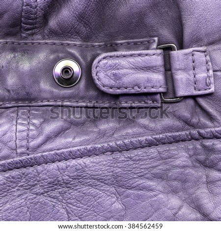 close-up fragment of violet leather jacket,strap, button - stock photo