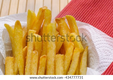 Close up, French fries sprinkled salt - stock photo