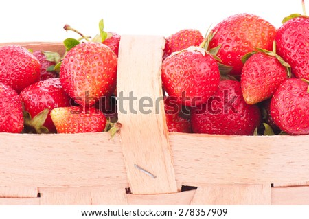 close-up fresh and ripe strawberry is gathered in a bast basket - stock photo