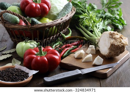 close up fresh assorted vegetables on rustic table background - stock photo