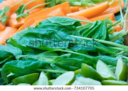 Close up fresh carrot and green vegetables