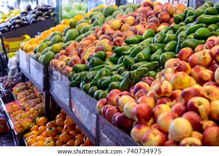 Close up Fresh fruit and vegetables at the counter of the vegetable shop, farmer marketplace. Organic, healthy, vegetarian diet food concept. Selective focus.