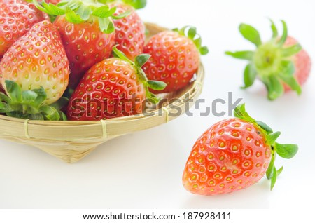 close up fresh red strawberries on wooden basket