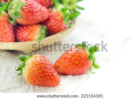 close up fresh red strawberries over sackcloth , ripe fruit