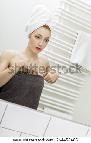 Close up Fresh Young Woman From Shower Looking her Face While Touching it In Front the Mirror